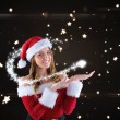 Sexy santa girl presenting with hand — Stockfoto #53899525