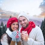 Winter couple holding mugs — Stock Photo #53899941