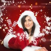 Pretty girl smiling in santa outfit — Stock Photo