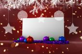 Composite image of poster with baubles — Foto Stock
