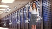 Businesswoman writing against server room — Stock Photo