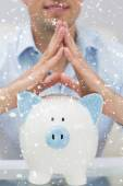 Mid section man with piggy bank at home — Stock Photo