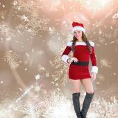 Sexy santa girl smiling at camera — Stock Photo