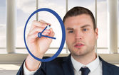 Business person drawing blue clock — Stockfoto