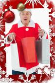 Festive man holding shopping bags — ストック写真