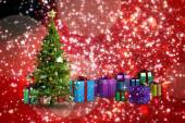 Composite image of christmas tree and presents — Foto Stock