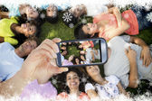 Multiethnic friends lying down in park — Stock Photo
