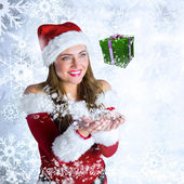 Girl in santa costume holding hand out — Stock Photo