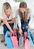 Smiling pair of girls looking at the shopping — Stock Photo