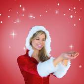 Santa girl holding hands out — Stock Photo