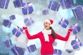 Composite image of festive brunette holding shopping bags — Stock Photo