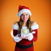 Girl in santa costume holding gift box — Stock Photo
