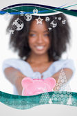 Pink piggy bank held by a young smiling woman — Stock Photo