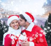 Festive young couple holding gift — Stock Photo