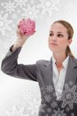 Bank employee taking close look at piggy bank — Stock Photo
