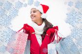 Beautiful festive woman holding shopping bags — Stock Photo