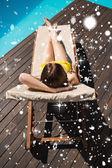 Beautiful woman in bikini relaxing by pool — Stock Photo