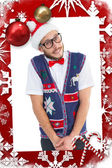 Composite image of geeky hipster in santa hat — Stock Photo