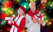 Festive couple with gifts — Stockfoto
