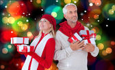 Festive couple with gifts — Стоковое фото