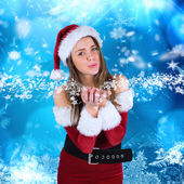Sexy santa girl blowing over hands — Stock Photo