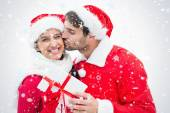 Attractive festive man giving girlfriend a kiss — Photo