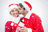 Attractive festive man giving girlfriend a kiss — Foto de Stock