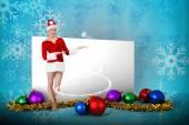 Pretty santa girl presenting with hands — Stock Photo