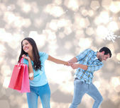 Couple with shopping bag — Stock Photo