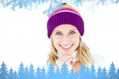 Merry woman with a colorful hat smiling — Stock Photo