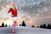 Girl smiling in santa outfit — Stock Photo