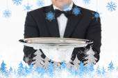 Man holding a silver tray with both hands — Stock Photo