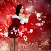 Pretty girl in santa outfit blowing — Photo