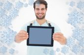 Handsome student showing his tablet pc — Stockfoto