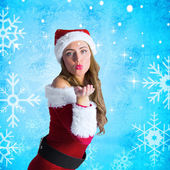Composite image of sexy santa girl blowing a kiss — Stock Photo