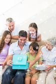 Family gifting birthday present to man — Foto Stock