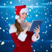 Pretty santa girl using tablet pc — Photo