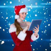 Pretty santa girl using tablet pc — 图库照片