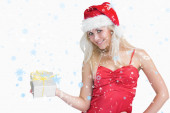 Composite image of happy woman with christmas present — Stock Photo