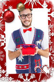 Geeky hipster offering christmas gift — Foto Stock