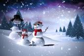 Composite image of snowman family — Stock Photo