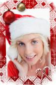 Young blonde woman putting on the santa claus — Foto de Stock