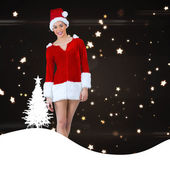 Santa girl smiling at camera — Stock Photo