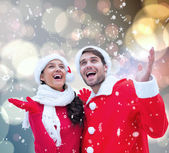 Composite image of festive young couple — Stock Photo