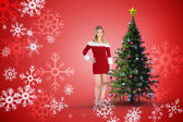 Pretty girl smiling in santa outfit — Stok fotoğraf