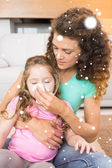 Mother helping daughter blow nose — Foto de Stock