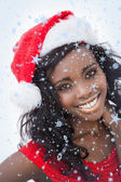 Woman wearing red dress and santa claus hat — Stock Photo