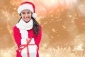 Festive brunette holding gift — Стоковое фото