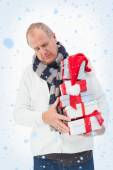 Mature man in winter clothes holding gifts — Foto Stock