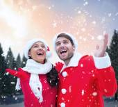 Festive couple against snowy landscape — Stock Photo